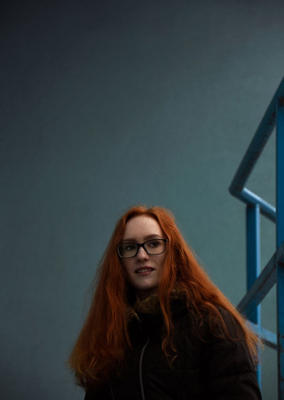 Alesya Gugaeva Blue Color Redhead Adult Beautiful Woman Blue Background Blue Colour Eyeglasses  Front View Glasses Hair Hairstyle Leisure Activity Lifestyles Long Hair Looking At Camera One Person Portrait Real People Standing Teenager Wall - Building Feature Young Adult Young Women EyeEmNewHere