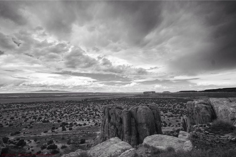 High Angle View Of Rock Formations And Arid Landscape Against Cloudy Sky