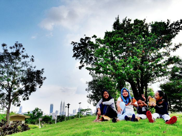 Togetherness Fun Family Grass Happiness Child Girls Daughter Outdoors Tree KLCC Twin Towers KL TOWER