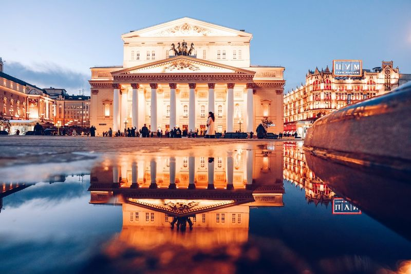 Building Exterior Built Structure Architecture Water Reflection Sky Nature Waterfront Travel Destinations Illuminated Incidental People City Building Transportation Travel The Past Reflecting Pool History Mode Of Transportation