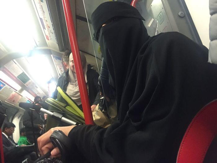 A fully covered Muslim woman in London Underground. Real People Lifestyles One Person Muslim Islam Veil Veiled Woman Burqa London London Lifestyle Veiled Hejab Black Metro Subway Underground Travel People Covered Public Transportation Public Transport Tourism EyeEmNewHere EyeEm Best Shots