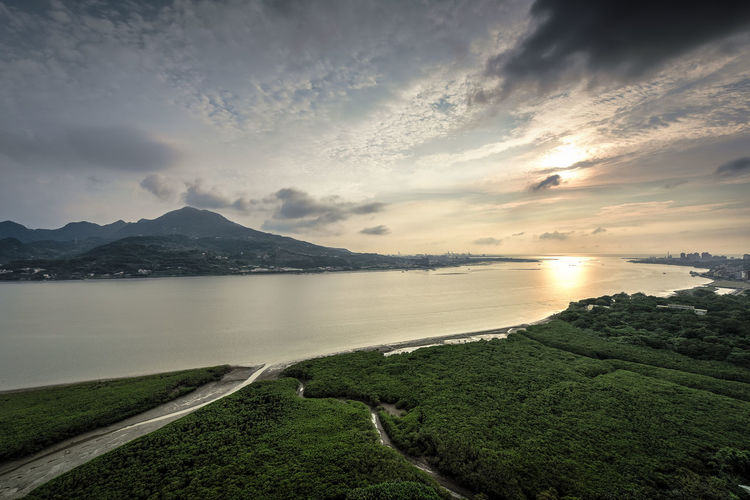 Tamsui river Sky Cloud - Sky Water Scenics - Nature Mountain Beauty In Nature Tranquility Tranquil Scene Nature No People Land Lake Road Plant Grass Environment Landscape Mountain Range Idyllic Outdoors Tamsui River Sunset River High Angle View Droneshot Drone Photography Dawn Clouds And Sky Contrast Beauty In Nature Silence Of Nature Reflection darkness and light Bird's Eye View