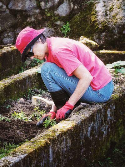 Woman planting at yard
