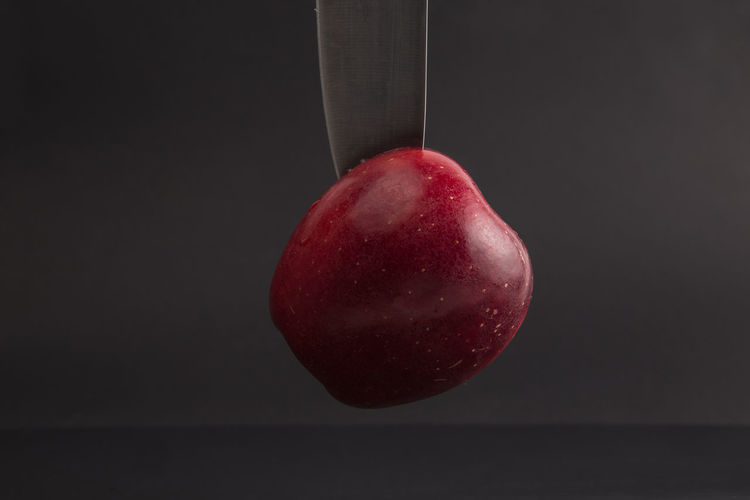 Red Food Healthy Eating Food And Drink Fruit Wellbeing Freshness Close-up Indoors  Single Object Apple - Fruit No People Studio Shot Hanging Black Background Still Life Ripe Copy Space Cherry Plant Stem Diet & Fitness Healthy