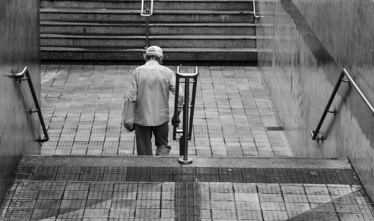 Adult Architecture Casual Clothing Day Footpath Full Length Leisure Activity Lifestyles Men One Person Outdoors Railing Real People Rear View Senior Adult Staircase The Way Forward Walking Walking Cane