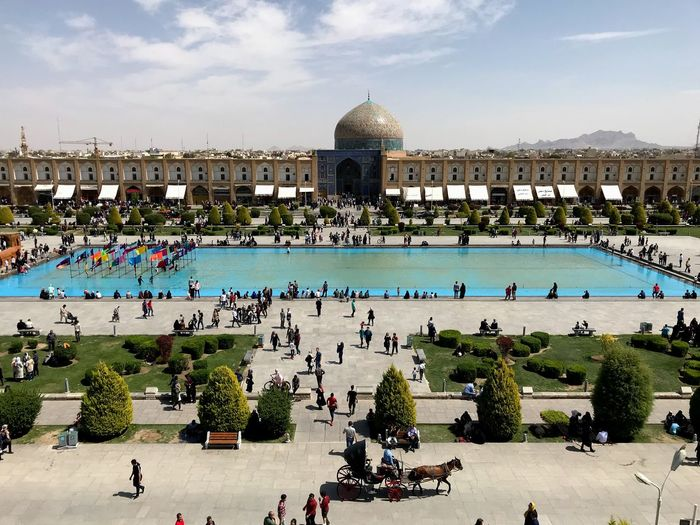 """Naqsh-e Jahan Square (Persian: میدان نقش جهان Maidān-e Naqsh-e Jahān; trans: """"Image of the World Square""""), is a square situated at the center of Isfahan city, Iran. Constructed between 1598 and 1629, it is now an important historical site, and one of UNESCO's World Heritage Sites. It is 160 metres (520 ft) wide by 560 metres (1,840 ft) long[1] (an area of 89,600 square metres (964,000 sq ft)). It is also referred to as Shah Square or Imam Square.[2] The square is surrounded by buildings from the Safavid era. The Shah Mosque is situated on the south side of this square. On the west side is the Ali Qapu Palace. Sheikh Lotf Allah Mosque is situated on the eastern side of this square and at the northern side Keisaria gate opens into the Isfahan Grand Bazaar. Today, Namaaz-e Jom'eh (the Muslim Friday prayer) is held in the Shah Mosque. Go Higher The Great Outdoors - 2018 EyeEm Awards The Street Photographer - 2018 EyeEm Awards The Art Of Street Photography The Mobile Photographer - 2019 EyeEm Awards"""