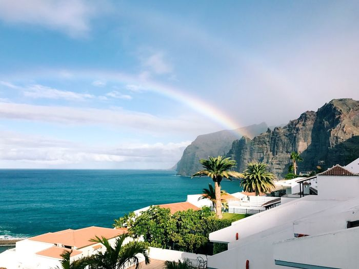Water Sea Sky Beauty In Nature Scenics - Nature Tree Nature Plant Beach Tranquil Scene Horizon Over Water Day Mountain Rainbow Tranquility Land Idyllic No People Outdoors Cloud - Sky