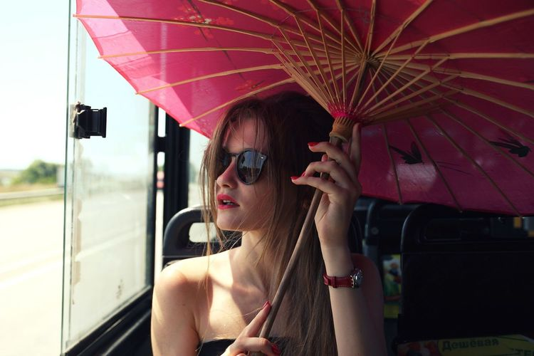 Portrait of young woman wearing sunglasses