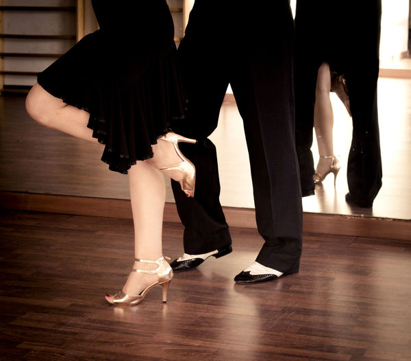 Adult Arts Culture And Entertainment Ballet Ballet Dancer Body Part Dancing Flooring Group Of People Hardwood Floor Human Body Part Human Foot Human Leg Human Limb Indoors  Low Section Performance Real People Skill  Tiptoe Togetherness Women Wood