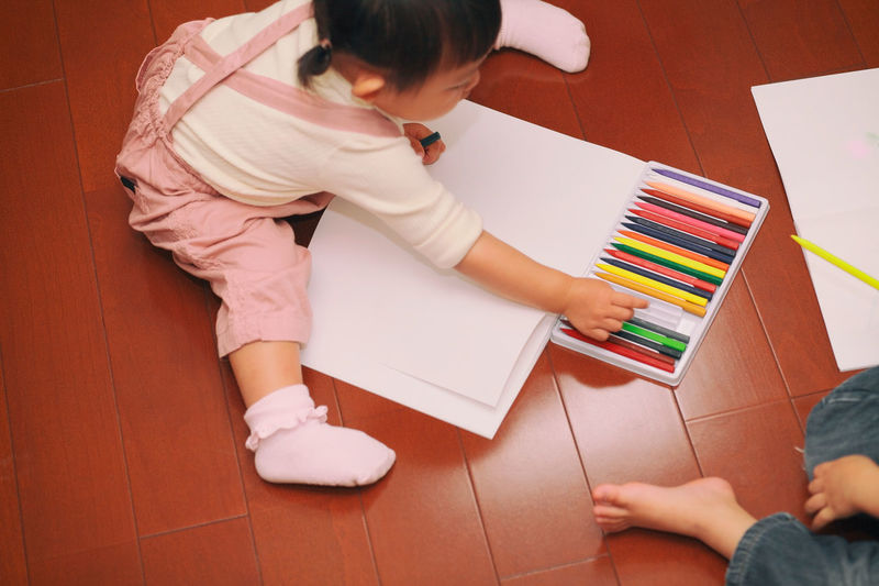 Children Crayons Creativity Friends Japan Japanese  Woman Boy Childhood Colorful Floor Girl High Angle View Home Interior Indoors  Lifestyles Notebook Painting Paper Playing Real People Sitting Togetherness Two People Wood - Material This Is Family This Is My Skin