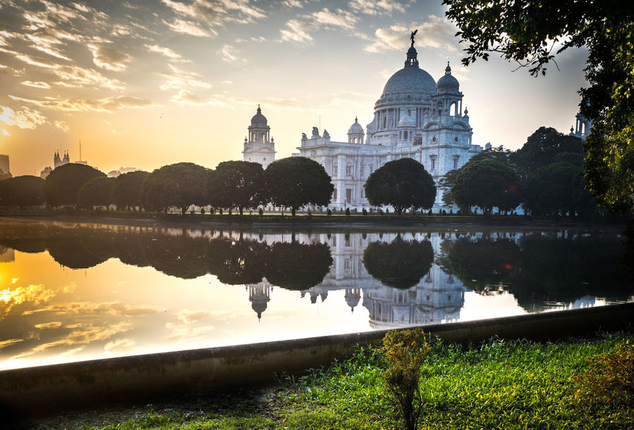 The Victoria Memorial Victoria Memorial Architecture Building Exterior Built Structure Cloud - Sky Day Dome History Lake Nature No People Outdoors Place Of Worship Reflecting Pool Reflection Religion Sky Spirituality Sunset Tourism Travel Travel Destinations Tree Water