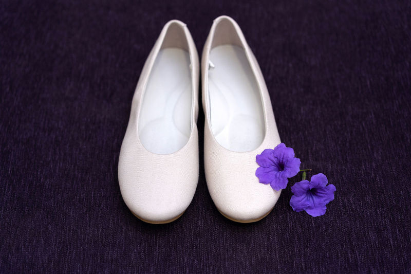 Simple white bridal shoe decorated with purple flowers Flower Flowering Plant Shoe Plant Close-up Purple Pair White Color Indoors  Freshness No People Nature High Angle View Beauty In Nature Fragility Still Life Vulnerability  Two Objects Petal Pink Color Decoration Bridal Shoes White Simple