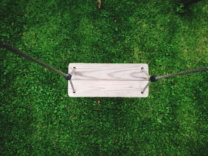 Directly above shot of swing over grassy field at park