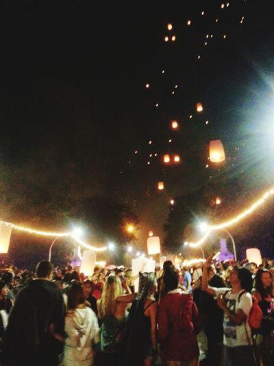 โคมลอย Night Large Group Of People Arts Culture And Entertainment Nightlife Crowd Music Illuminated