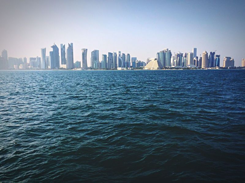 Doha,Qatar City Sea Cityscape Skyscraper Waterfront Clear Sky Building Exterior Outdoors Water Downtown District Urban Skyline Day No People