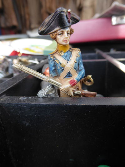 Napoleon Art And Craft Child Childhood Clothing Day Fleamarket Front View Full Length Indoors  Lifestyles Looking Looking Away Mode Of Transportation Occupation One Person out of the box Real People Table Tin Soldier Toy Transportation