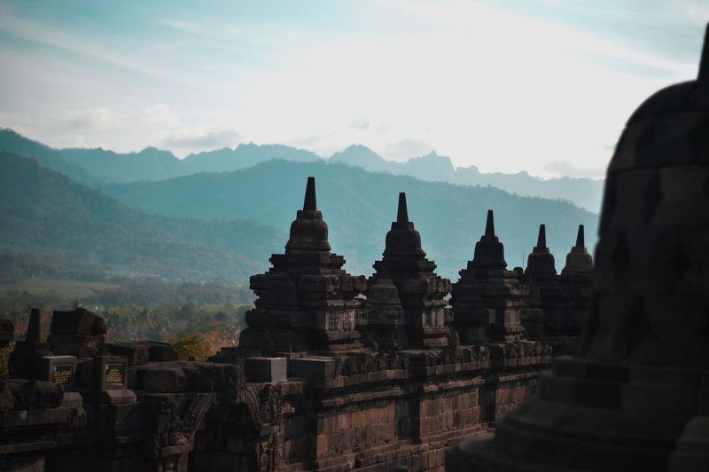 Stupas of temple against sky