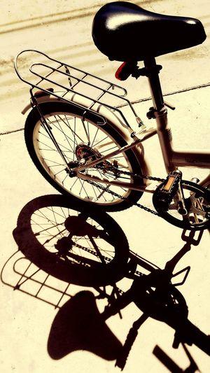 Bicycle, no person, shadow