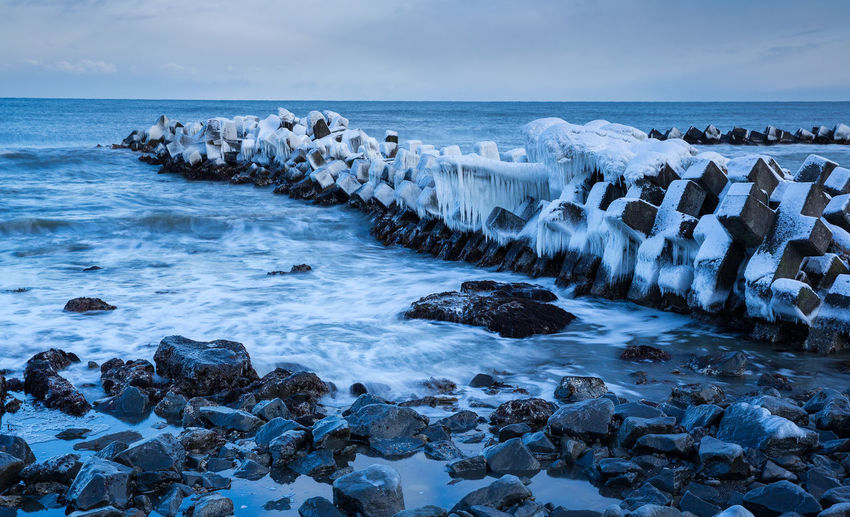 Water Sea Sky Rock Land Scenics - Nature Beauty In Nature Beach Horizon Over Water Nature Solid Horizon Rock - Object Motion Wave Idyllic Day Remote Tranquil Scene No People Outdoors Groyne Tetrapod Snow Ice