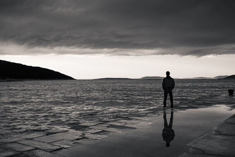 Croatia Pier Reflection Adults Only Black And White Blackandwhite Cloud - Sky Horizon Over Water Men Nature One Man Only One Person Outdoors People Real People Rear View Sea Standing Sunsets Tranquility Water Black And White Friday Inner Power