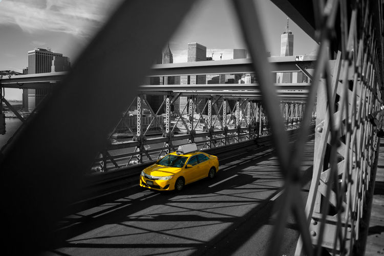 Yellow bridge over street in city