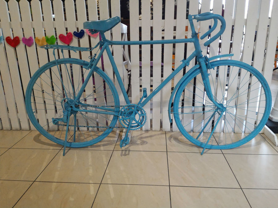 Blue old painted bike decoration Bike Blue Bycicle Creative Creativity Decor Decoration Exterior Design Fence Hearts Idea Indoors  Interior Design No People Outdoors Painted Parked Simple Simplicity Solution The OO Mission Vintage White