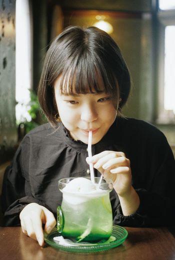 Portrait of boy drinking glass
