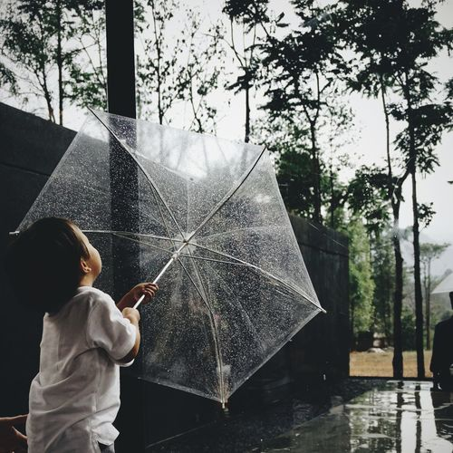 EyeEmNewHere Boy Little Kid Child Family Small Holding Fun Umbrella Raining Relax Day Children Childhood Children Photography Portrait People Asianboy Fashion Nice Little Boy Naughty Boy Love Fresh