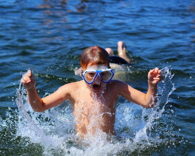 Crazy kid Sweden Summertime Real People Light Skin Watersplash Blue Wave Salt Water EyeEm Selects Water Swimming Child Portrait Childhood Males  Boys Sea Shirtless Summer Swimming Goggles Diving Equipment Scuba Mask