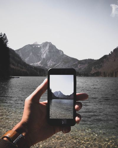 Iphone 📱 7. Wireless Technology Human Hand Mountain Smart Phone Mobile Phone Portable Information Device Holding Photographing Photography Themes Mountain Range Communication Photo Messaging Using Phone Technology Cellphone Lake Day Human Body Part Nature Connection