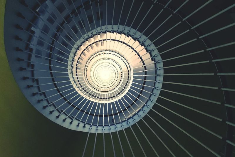 Directly below shot of spiral staircase in hospital de cruces