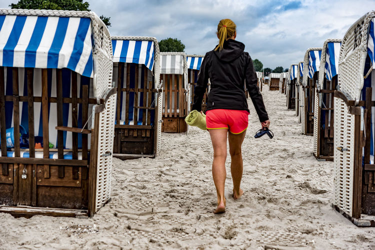 one woman Baltic Sea Beach Beach Chairs Blond Hair Blue Sky And Clouds Clouds And Sky No People One Woman Only Sand Scharbeutz Schleswig-Holstein Shorts White And Blue Stripes White Beach Chairs