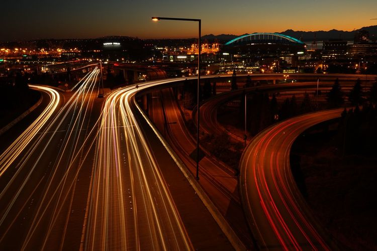 High angle view of light trails on street at dusk