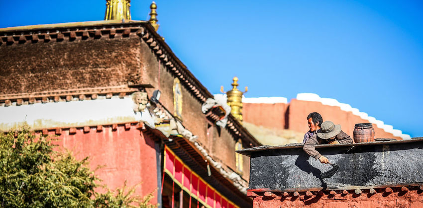 Annual painting work for the palace of God. Architecture Building Exterior Outdoors Painting People Place Of Worship Religion Tibetan Buddhism Tibetan Culture Tibetan Monastery Travel Destinations
