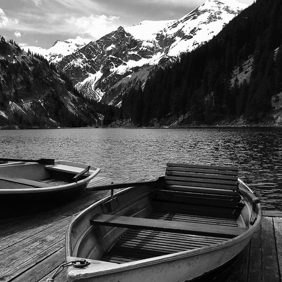 boats at vilsalpsee, tannheimer tal Life Light Tannheimer Tal Tirol  Travel Alps Beauty In Nature Black And White Clouds Lake Moored Mountain Mountain Range Nature Nautical Vessel Outdoors Scenics Shadow Sky Snowcapped Mountain Spring Tranquil Scene Transportation Vilsalpsee Water Modern Hospitality