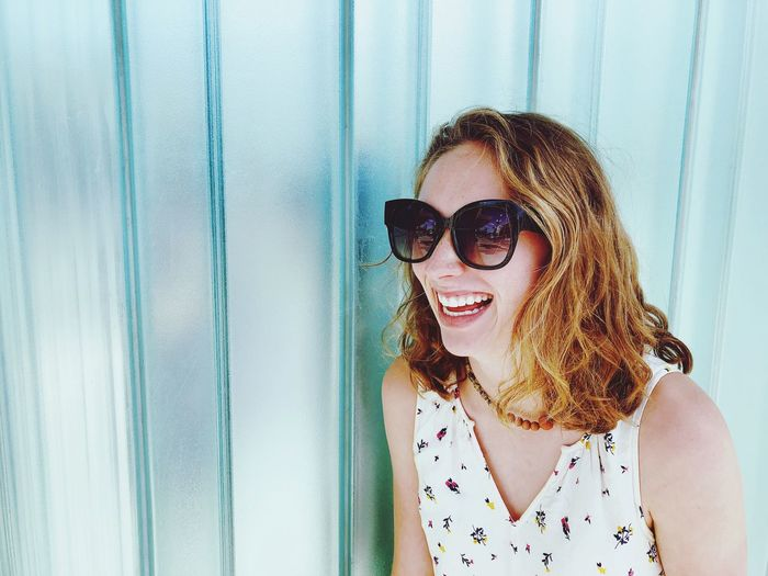 Girl with glasses laughing Sunglasses One Person Fashion Glasses Portrait Real People Headshot Young Women Women Beauty Young Adult Leisure Activity Hair Front View Adult Day Hairstyle Lifestyles Smiling Happiness