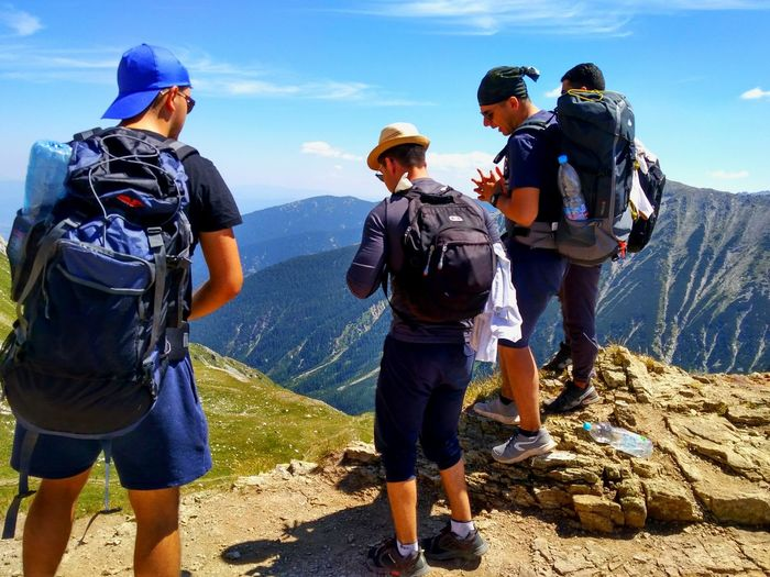 Men Adult Mountain Group Of People Sport People Only Men Headwear Outdoors Sports Team Friendship Young Adult Day Sky Adults Only EyeEmNewHere EyeEm Best Shots EyeEmBestPics Travel Nature Rear View Green Color Beauty In Nature Top Of The Mountains Been There.