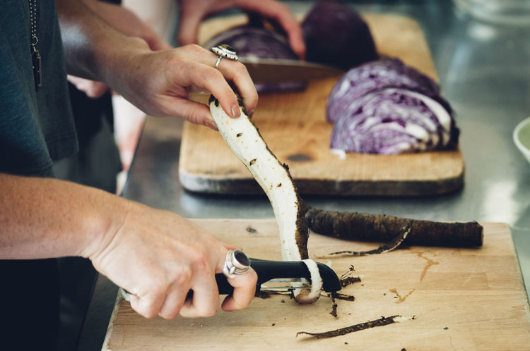 Adult Adults Only Burdock Cabbage Chopping Close-up Cooking Cutting Board Day Human Body Part Human Hand Indoors  Mid Adult Occupation One Person One Woman Only Only Women People Sauerkraut Skill  Work Tool Workshop