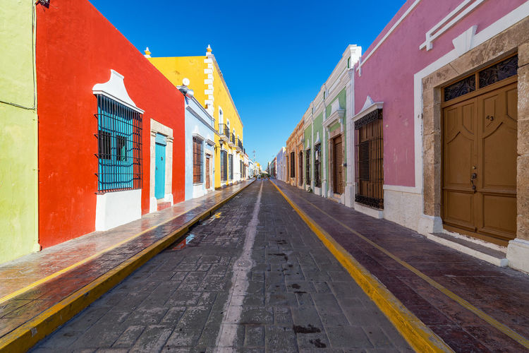 Colorful empty colonial street in the historic center of Campeche, Mexico America Architecture Building Campeche Caribbean City Cityscape Colonial Downtown Heritage Historic Houses Landmark Latin Mexican Mexico Spanish Square Street Town Unesco UNESCO World Heritage Site Urban Yucatan Mexico Yúcatan