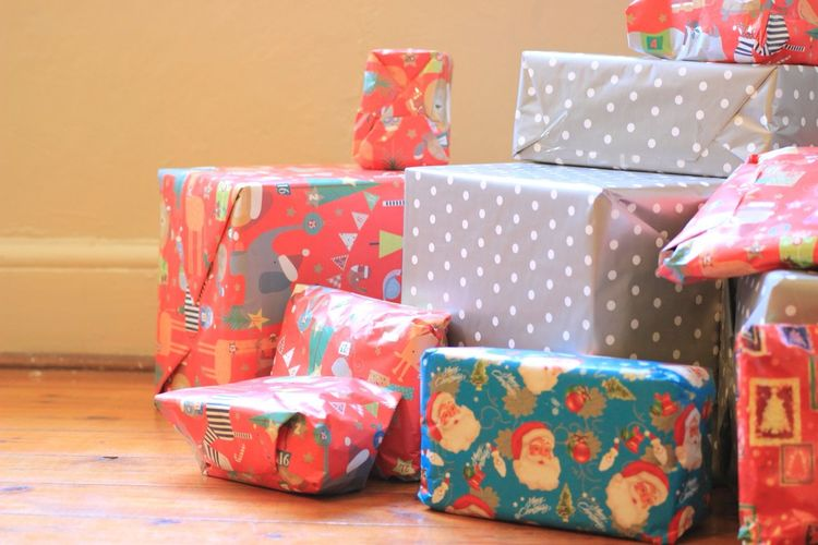 A gift for you Holidays Cheer Gift Christmas Christmas Present Wrapping Paper Wrapped Indoors  Celebration Tradition Box - Container No People Holiday - Event Multi Colored Unwrapping Stack