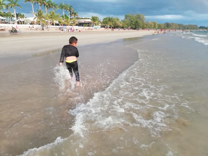 Children enjoy on summer trip 2019,หาดเจ้าหลาว Achi2019 Rear View Water One Person Motion Lifestyles Real People Sea Sport Surfing Leisure Activity Aquatic Sport Nature Day Beach Land Wave Beauty In Nature Sky Outdoors