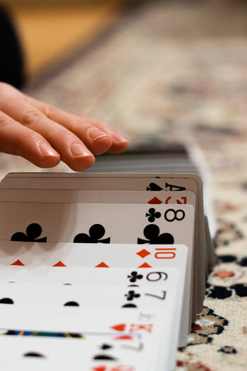 Close-up of hand playing cards