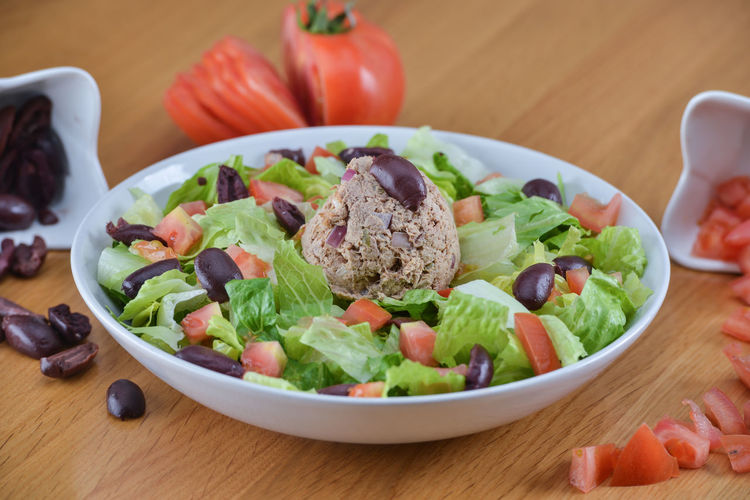 Close-up of salad served on table
