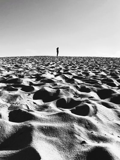 Lonely Sea Sky Land Beach One Person Water Nature Clear Sky Horizon Day Leisure Activity Tranquility Scenics - Nature Beauty In Nature Real People Tranquil Scene Full Length Sand Horizon Over Water Outdoors Monochrome Lonely Alone Desert Melancholy