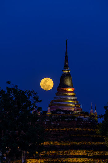 Super moon in night sky and silhouette of ancient pagoda is named Wat Ratchaburana, Phitsanulok in Thailand Religion Rainbow River Silhouette Sky Phitsanulok Place National Nature Night Pagoda Skyline Southeast Traditional Tourism Travel Vacations Wat Thailand Thai Spirituality Sunset Super Moon Temple Myanmar Moon Blood Moon Blood Buddha Buddhism City Beautiful Bangkok Architecture ASIA Asian  Background Cityscape Cloud Landmark Landscape Light Local Full Moon Full Colorful Culture Destinations Famous Ancient