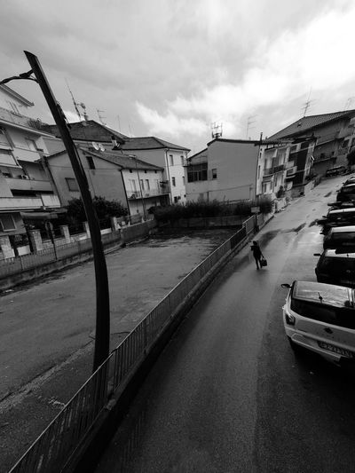 delay Black And White Streetphotography Fisheye FishEyeEm Sky Architecture Built Structure Building Exterior Transportation Cloud - Sky City Road Day Incidental People Motor Vehicle The Way Forward