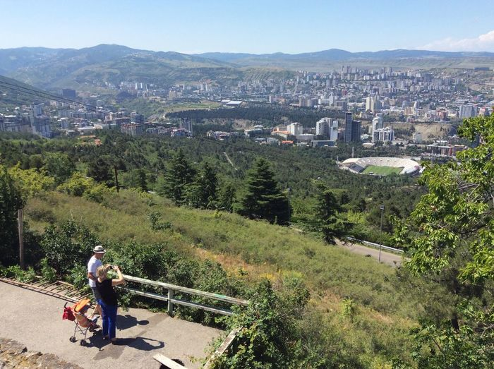 Tourists snapping some photos. View from near Turtle Lake. Tbilisi Turtle Lake