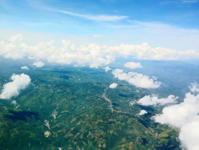 A Bird's Eye View Aerial View Airplane Travel Flying Sky Landscape Plane Window Clouds And Sky Colors Vegetacion Green Fields