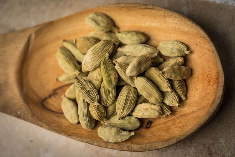 Close-up of cardamoms in spoon