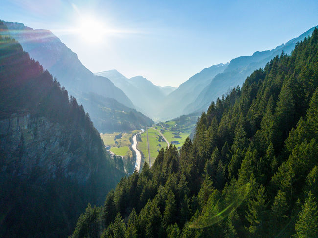 Adventure Beauty Beauty In Nature Day Green Color Grindelwald Landscape Mountain Mountain Range Nature No People Outdoors Scenics Sky Sun Sunlight Switzerland Tree Valley